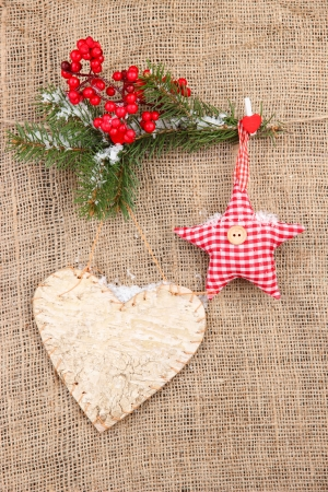 Decorative heart and star on rope, on burlap background photo