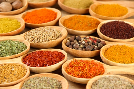 Assortment of spices in wooden spoons close-up