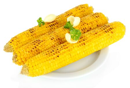 Delicious golden grilled corn with butter isolated on white photo