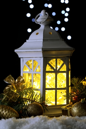 Decorative glowing lantern at night photo