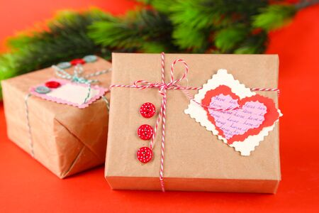 Paper gift boxes on  color background photo