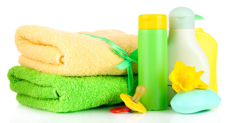 Baby cosmetics, soap and towels, isolated on white photo