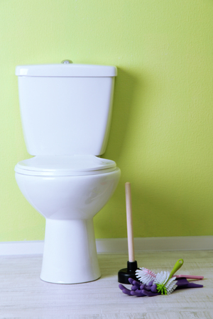 White toilet bowl and cleaner things in a bathroom Stock Photo - 24622839