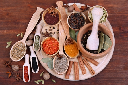Various spices and herbs on wooden table photo