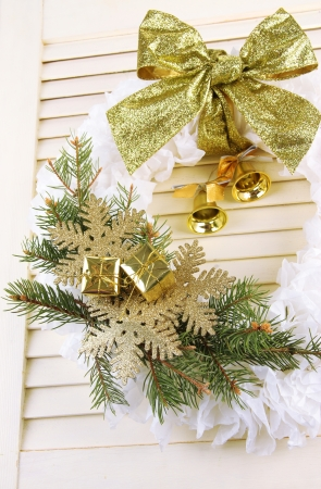 Christmas wreath on wooden background photo