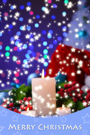 Candles and Christmas decoration on bright background photo