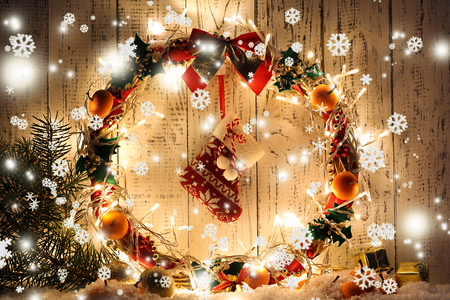 Beautiful Christmas wreath, on wooden background photo