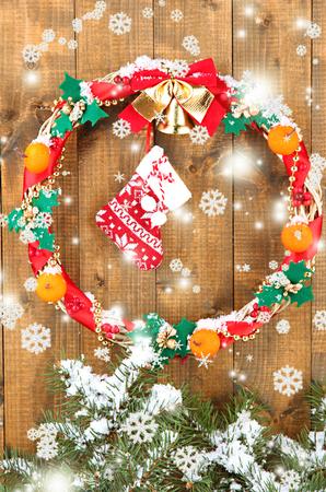 Beautiful Christmas wreath, on wooden background photo