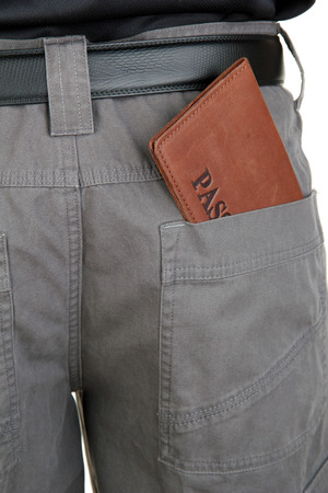 immigrate: passport in back pocket close-up