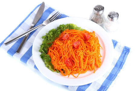 Carrot salad on plate on napkin isolated on white  photo