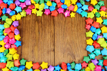 Paper stars with dreams on wooden background Stock Photo - 24846794