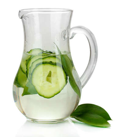 Cold water with cucumber and ice in pitchers isolated on white photo