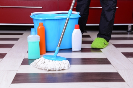 tidiness: House cleaning with  mop Stock Photo