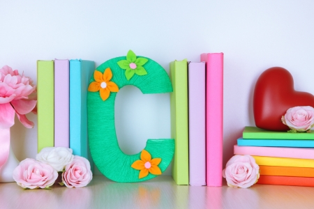 Shelf decorated with handmade knit letter photo