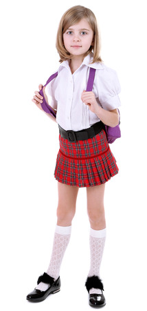 uniform skirt: Beautiful little girl with backpack isolated on white