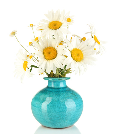 Beautiful bouquet chamomiles in vase isolated on white photo