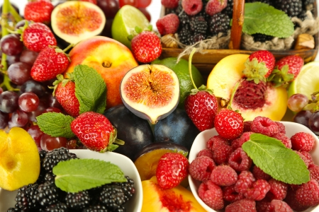 Assortment of juicy fruits and berries background photo