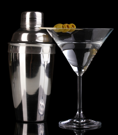 barmen: Martini glass with olives and shaker isolated on black