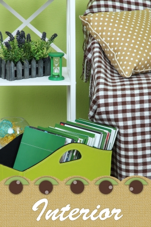 Magazines and folders in green box on floor in room photo
