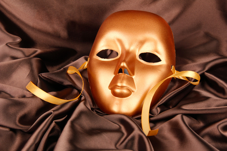 canvass: Mask on brown fabric background