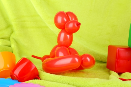 Simple balloon animal dog, on bright background photo