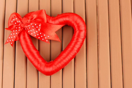 Decorative heart, on wooden background photo