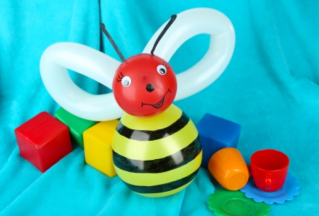 Simple balloon animal bee, on bright background photo