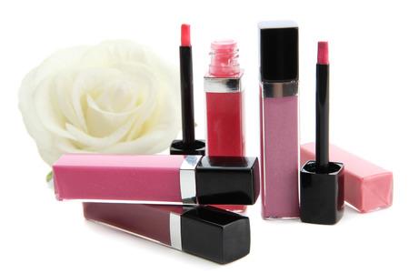 cosmetologist: Beautiful lip glosses, isolated on white Stock Photo
