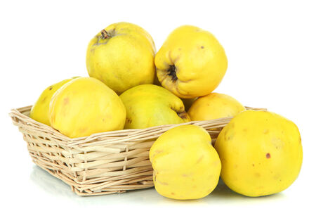 quinces: Sweet quinces in wicker basket isolated on white