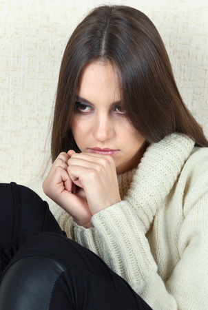Lonely sad woman near wall Stock Photo - 26397767