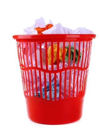 Full garbage bin, isolated on white photo