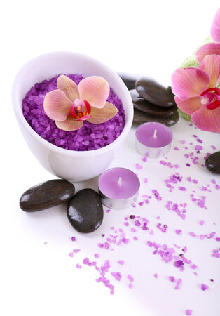 Color sea salt in glass bowl, spa stones and  orchid flower, isolated on white photo