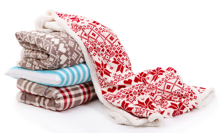 throw cushion: Warm plaids and pillows isolated on white