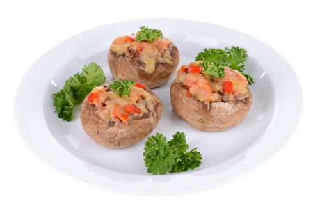 Stuffed mushrooms on plate isolated on white photo