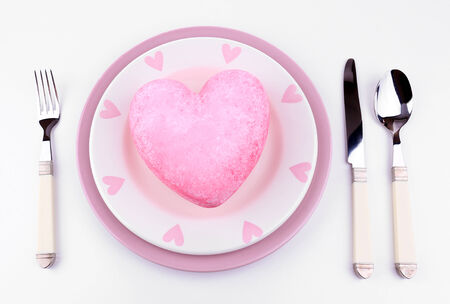 Heart on plate, isolated on white photo