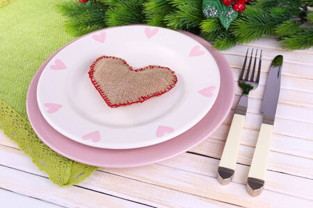 Set of utensil for romantic dinner, on table, on light background photo