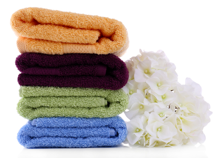 absorb: Colorful towels and flowers, isolated on white