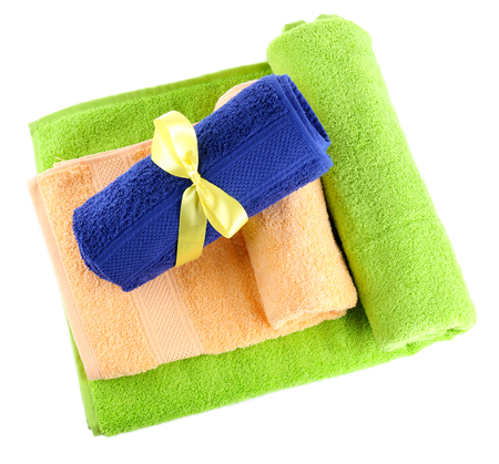 absorb: Colorful towels isolated on white Stock Photo