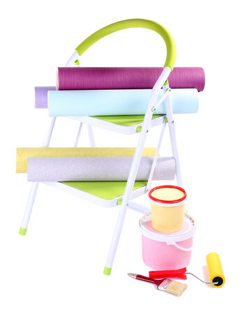 Small ladder and wallpaper rolls, isolated on white photo