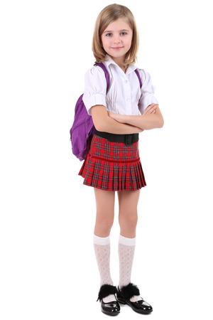 zapatos escolares: Ni�a hermosa con el morral aislado en blanco Foto de archivo
