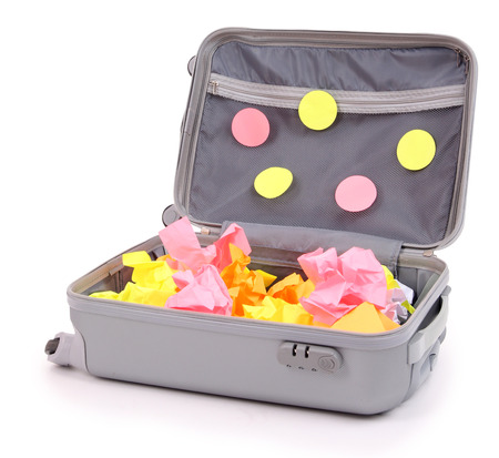 trundle: Open suitcase with paper stickers isolated on white