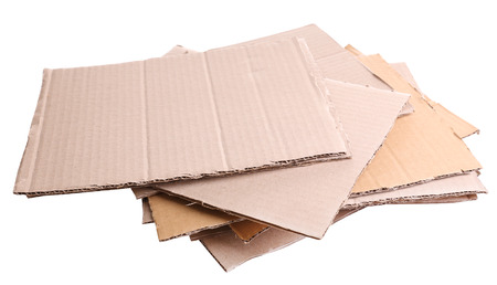 Stack of cardboard for recycling isolated on white photo