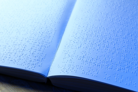 Book written in braille alphabet for blind people photo