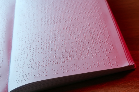 blind people: Book written in braille alphabet for blind people Stock Photo