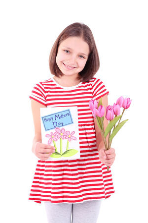 Beautiful little girl with flowers and postcard in her hand, isolated on white photo