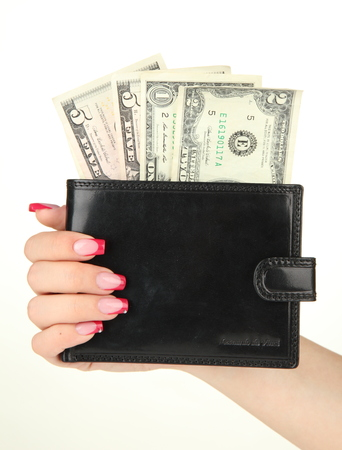 Female hand holding black wallet, isolated on white photo