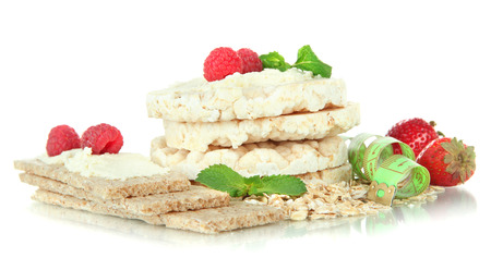 Tasty crispbread with berries, isolated on white photo