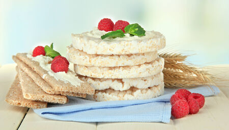 Tasty crispbread with berries, on white table photo