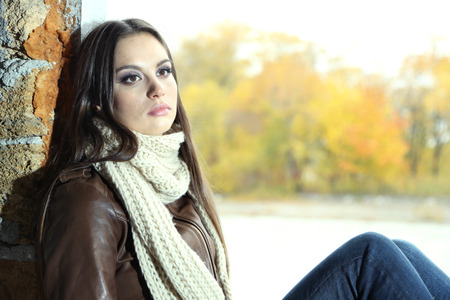 Portrait of young serious woman outdoors photo