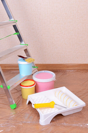 Metal ladder and paint in room photo